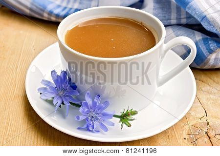 Chicory drink in white cup with flower on board