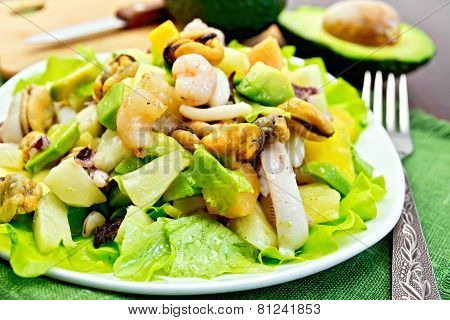 Salad seafood and avocado on napkin