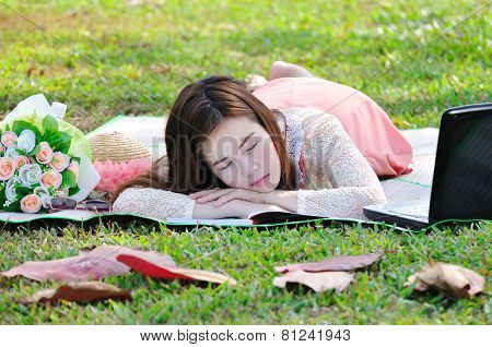 Women Sleeping On Wooden Mat In Relax Time.