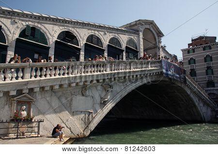 Rialto Bridge In Venice Italy With Tourists