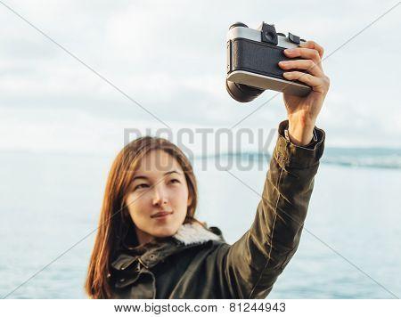 Smiling Woman Takes Photographs Selfie Portrait