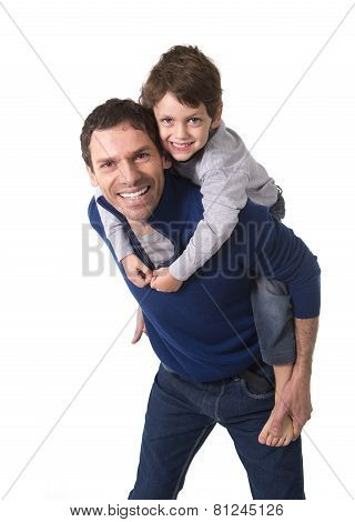Young Happy Brazilian Father Carrying On His Back Little Son Smiling And Having Fun Together
