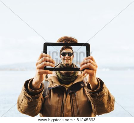 Hiker Man Doing A Self-portrait With Digital Tablet