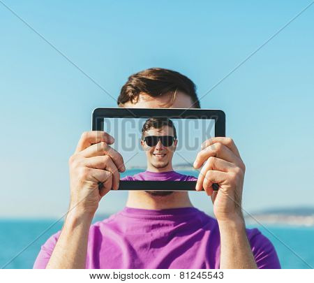 Man Doing Self-portrait With Digital Tablet