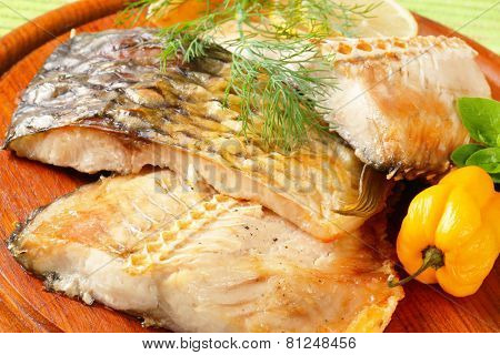 Oven baked carp fillets with dill