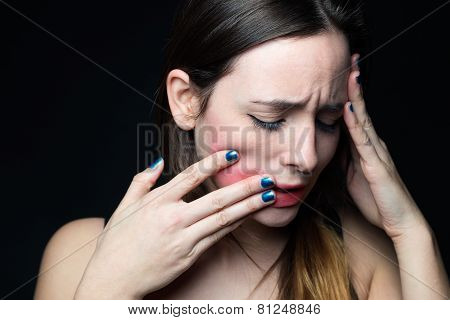Desperate Young Woman Touching Her Face. Concept Of Abuse And Despair.