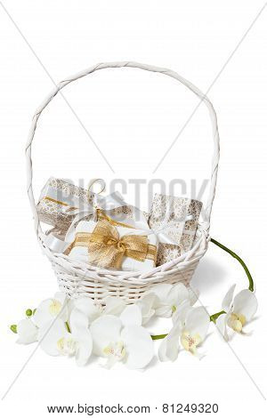 Isolated white and gold gift boxs in basket