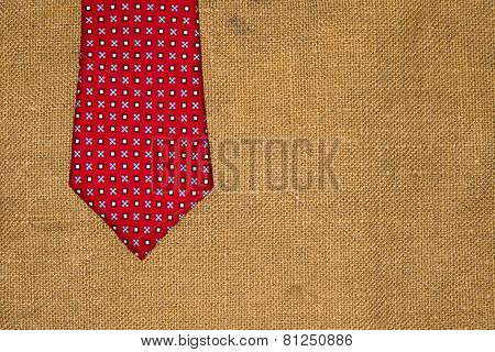 Beautiful Red Tie On The Old Sacking