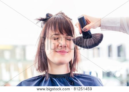 Female coiffeur cutting women hair in hairdresser shop, brushing away stuff