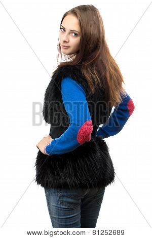 Image of woman in fake fur waistcoat from the back