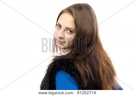 Portrait of woman in fake fur waistcoat from back