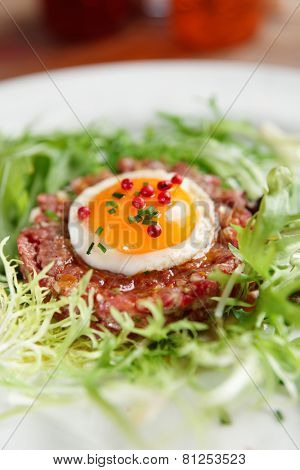 Beef tartare in plate, close-up