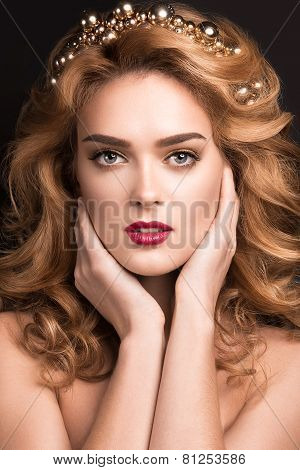 Beautiful blond girl in the image of a bride with a tiara in her hair. Picture taken in the studio o