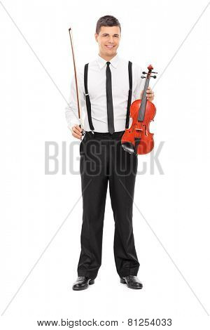 Full length portrait of a young male violinist posing isolated on white background