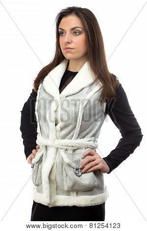 Portrait of the brunette in fake fur waistcoat