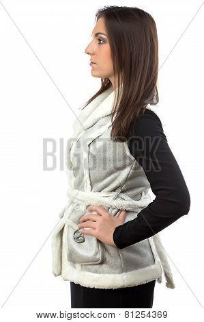 Photo of brunette in fake fur waistcoat - profile