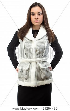 Image of serious brunette in fake fur waistcoat