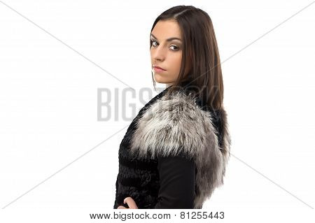 Portrait of woman in fur waistcoat from the back