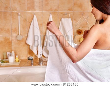 Woman relaxing at water in bubble bath.Girl takes bath towel before