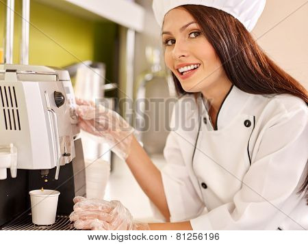 Waitresses with coffee machine at cafeteria. Woman pours coffee