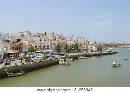 View to Ferragudo town from across the Rio Arade in Ferragudo, Portugal.
