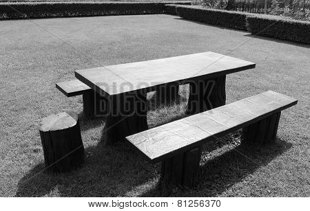 Wooden Table And Chair On The Lawn Yard