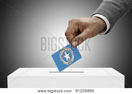 Black Male Holding Flag. Voting Concept - Commonwealth Of The Northern Mariana Islands