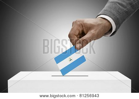 Black Male Holding Flag. Voting Concept - Nicaragua