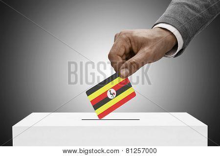 Black Male Holding Flag. Voting Concept - Uganda