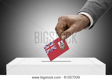 Black Male Holding Flag. Voting Concept - Bermuda