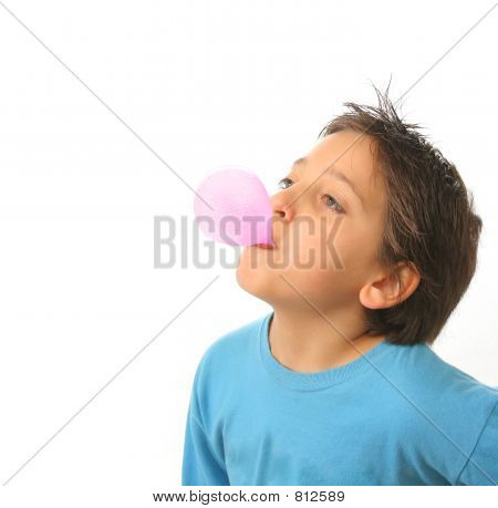 Boy blowing a pink bubble gum