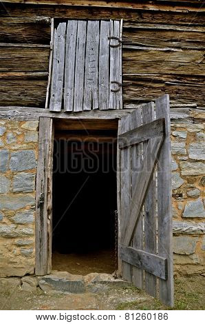 Open door to a log building
