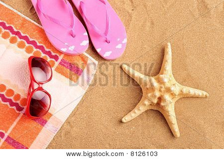 Towel, sandals, sunglasses and starfish