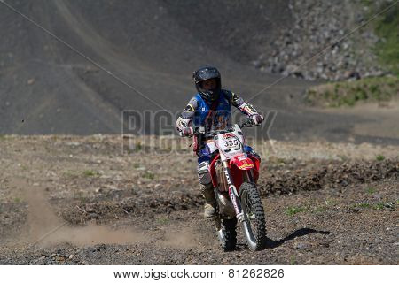 SOCHI, RUSSIA – AUGUST 16, 2014: Off-road motorcycle rider trains in summer mountains
