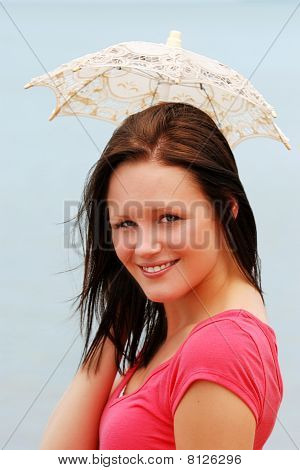 young woman with small lace umbrella