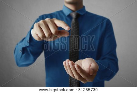 Man hands holding something, open space between them