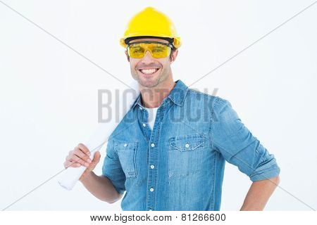 Portrait of happy architect holding rolled blueprint over white background