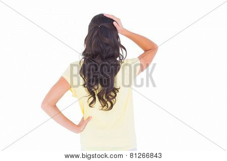 Brunette thinking in rear view on white background