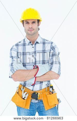 Portrait of male technician with arms crossed over white background