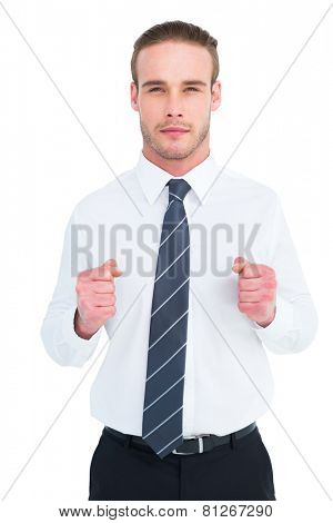 Unsmiling businessman presenting his fists on white background