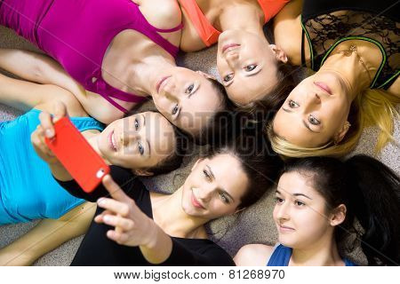 Group Of Beautiful Sporty Girlfriends Taking Selfie, Self-portrait With Smartphone View From Top