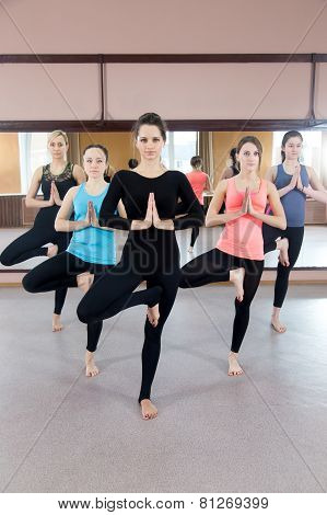 Group Of Five Yogi Females Doing Yoga Practice