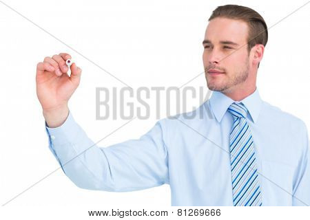 Concentrated businessman in shirt writing with marker on white background