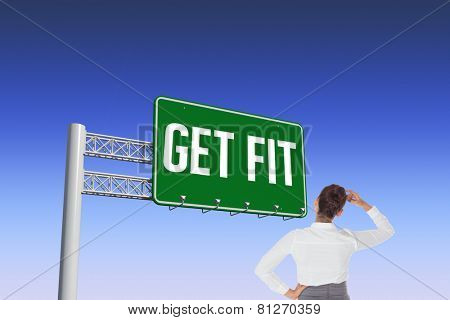 The word get fit and businesswoman scratching her head against blue and purple sky