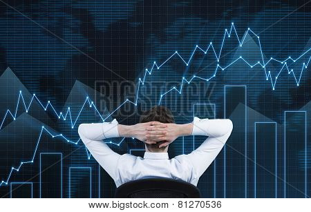 Businessman Looking On Chart