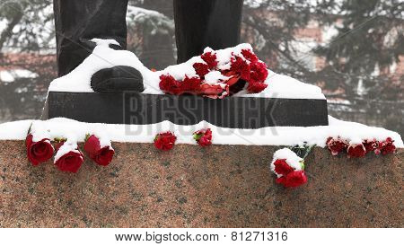 Flowers At A Monument Foot