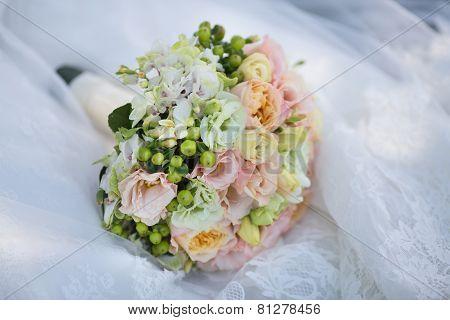 Wedding Bouquet on Bride's Dress