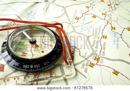 Compass and trekking map. Color image