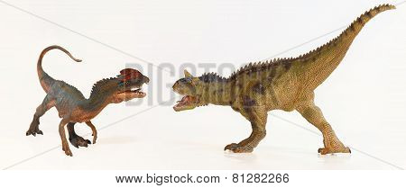 A Dilophosaurus And A Carnotaurus Face Off
