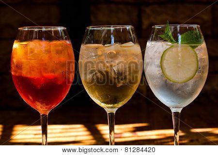 Cocktails: Aperol Spritz, Sprizz (spriss), Martini Royale. (dark Background). Sparkling Wine. Champa